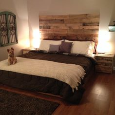 Thanks to Brandon and Pinterest, we have a pallet board bed and nightstands! www.facebook.com/teeagoans