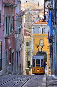 The Bica funicular, a.k.a. Elevador da Bica on Calçada da Bica Pequena @ Travessa do Cabral in Lisbon, Portugal. https://www.google.ca/maps/place/Elevador+da+Bica/@38.7093678,-9.1467598,19z/data=!4m13!1m7!3m6!1s0xd19348095e0284b:0xad12a6e97cf59bd6!2sCal%C3%A7ada+da+Bica+Pequena,+1200-109+Lisboa,+Portugal!3b1!8m2!3d38.7089639!4d-9.1466042!3m4!1s0x0:0x4210938d4ca6b12c!8m2!3d38.7094096!4d-9.1463871