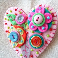 Beaded felt heart. I love the layered colors and buttons. Valentine's Day!