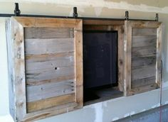 Flat Screen TV Cabinet with barn door slider with distressed wood