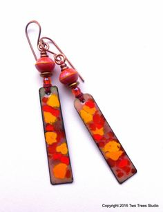 Beautiful handcrafted artisan earrings with richly colored lampwork beads and enameled copper, by Two Trees Studio.