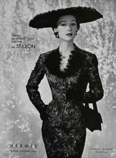 A vintage Hermes ad featuring a model in an elegant, figure hugging suit and wide-brimmed hat