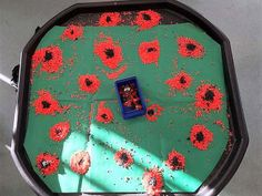"For Early Years, Terri-Leigh had this idea for a Tuff tray for Remembrance Day. She said, ""After a successful rangoli pattern tuff tray we decided to colour some more rice to create some poppies. The children enjoyed it! Remembrance Day Activities, Remembrance Day Art, Autumn Activities, Activities For Kids, Baby Room Nursery School, Baby Crafts, Crafts For Kids, Poppy Craft For Kids, Tuff Spot"