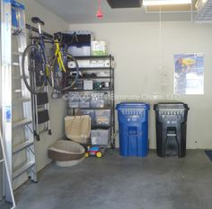 """AFTER: The workbench was removed and replaced with a versatile IP shelf. Contents were downsized, sorted, and stored in clear bins. Trashcans that were once in the way now have a """"home"""" and room to open!"""