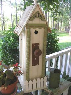 'Trash to Treasure' DIY Craft Projects using Old Shutters ~ Shutters are used as the sides of this bird house that uses multiple pieces of reclaimed building materials. Bird Cages, Bird Feeders, Diy Craft Projects, Diy Crafts, Old Shutters, Trash To Treasure, Fairy Houses, Yard Art, Backyard