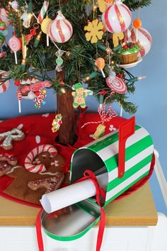 "Put a mailbox in your Christmas tree for the kids to leave their wish list for Santa.  On Christmas morning have the kids check the mail box to find a small gift/treat from Santa with a note saying, ""Thank you for being so good this year!"""
