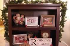 for the holidays, she swapped out all the pics in her frames with cards they used each year for their Christmas cards- cute idea (or frame each year's family Christmas photo and set out together)