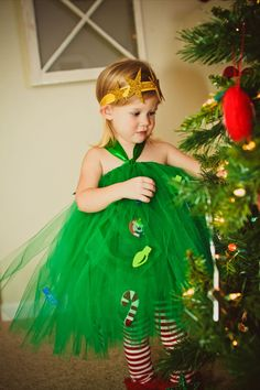 Inspired by a fresh cut evergreen Christmas Tree. A Tutu Dress made from Green Tulle featuring a green Halter Tie and Sash. Adorned with Christmas Bul… Christmas Dance Costumes, Christmas Tree Costume, Christmas Tutu Dress, Christmas Baby, Christmas Crafts, Whoville Costumes, Funny Halloween Costumes, Tap Costumes, Running Costumes