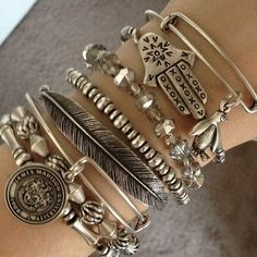 We love stacking Alex and Ani bangles...a great way to dress up a Sevenly tee! :)
