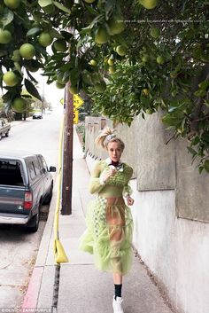 Fashion run: The Bloodline star is photographed running in a lace apple-green Gucci dress ...