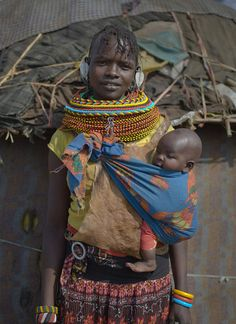 Africa | Turkana mother with her baby, Nakuprat village, Nakuprat-Gotu Community Conservancy, Kenya | © Chris Jordan