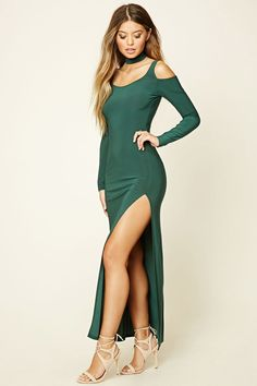 A knit maxi dress featuring a choker neckline with a cutout scooped chest and back, a bodycon silhouette, open-shoulder long sleeves, an exposed zipper in back, and a high side slit.