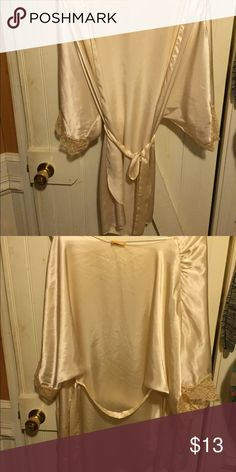 White silky robe Never used. Fits anywhere from a small to a large Other