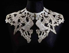 René Lalique http://www.thesterlingsilver.com/product/0-61-cts-sparkles-diamond-earrings-in-sterling-silver-real-diamonds/