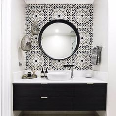 Dramatic black and white bathroom from @embracingspace. Amazing what tiling can do to a space. Milli Axon basin mixer with its black spout is the perfect addition here.
