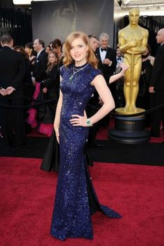 Amy Adams in a L'Wren Scott gown with Cartier diamond and emerald jewellery at the Oscars in 2011.