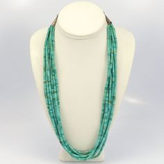 """Vintage (1970s) Six Strand Turquoise Heishi Bead Necklace with Hand Rolled Heishi Beads. This necklace also features sterling silver cones and clasp. 25.25"""" Necklace Length"""
