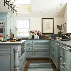 Love this kitchen color,  lighting and all!