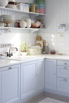 pastel cabinets, white subway tile, open shelving kitchen