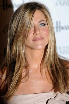 Jennifer Aniston hair...I love it!!!  My hair would never do this...but a girl can dream :)