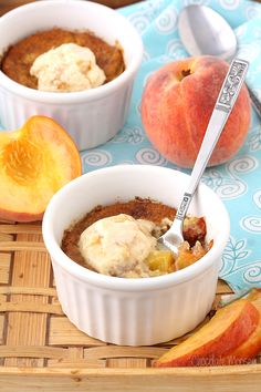 Peach Cobbler For Two is the perfect summertime dessert to share (or not). Warm, bubbly peaches topped with tender dough and ice cream.