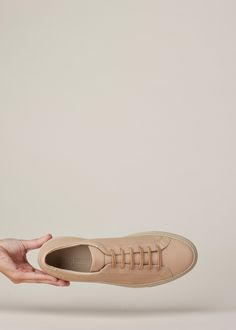 c2d23320ae7 Low top sneakers in taupe nappa leather. 1