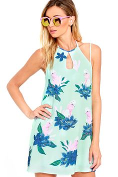 A quirky print, featuring tropical birds and exotic flowers, makes the Mink Pink What a Galah Mint Green Print Swing Dress totally vacation ready! Tying halter straps and adjustable spaghetti straps support a darted bodice with an apron neckline and cutout. Woven, swing silhouette.