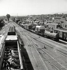 "https://flic.kr/p/dPc6Xv   Needles, California, Jack Delano, 1943   March 1943. ""Needles, California. A general view of the Atchison, Topeka & Santa Fe rail yard."" Photo by Jack Delano, Office of War Information.  Shorpy"
