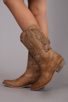 These are the most COMFORTABLE cowboy boots you will ever put on! These are not your average boots, they are extremely lightweight:) Thanks to the amazing color, they will practically match EVERYTHING! We promise you will wear these over and over.