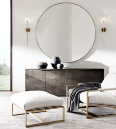 Restoration Hardware Modern round mirror in brass above the console in the dining space.