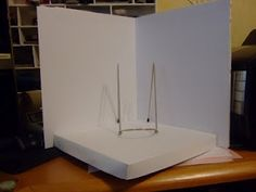 Foam board unit for photographing cards.