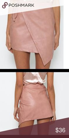 "Pink leather wrap skirt PepperMayo ""Austin Skirt"" from PepperMayo. US medium but does have a bit smaller of a waist. Not actual leather but a very good quality material. Worn once for a few hours and I'm perfect condition. Will post actual pics by request. Not desperate to get rid of yet, please message me before buying and feel free to ask questions! Paid 45 +int shipping  Brandy Melville Tobi PacSun PepperMayo Mura Xenia ShowPo LF Boutique Urban Outfitters Forever 21 American Apparel…"