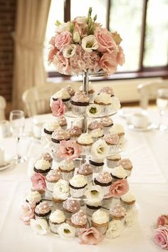 Cupcake tower at each table instead of one big cake!