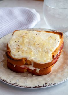 "A French-style grilled ham and gruyere cheese sandwich with Dijon mustard, topped with béchamel sauce and broiled until bubbly. The name is derived from the French words ""croquer,"" meaning ""crunch"" or ""bite"" and ""monsieur"" or ""mister."""
