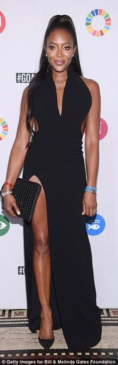 Stunning: Naomi Campbell looked incredible in the black gown that featured a thigh-high slit and plunging neckline at The Goalkeepers Global Goals Awards in New York City on Tuesday