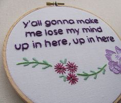 cross-stitched and embroidered rap lyrics... too funny if these were on the wall at grandma's...