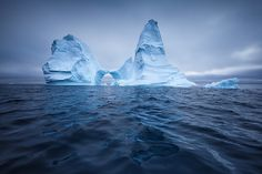 Our #GreenlandTakeover this weekend is going #iceberg overload with the beautiful pictures of @erezmarom!  2/6:  THE FLOATING CASTLE This was without a doubt the most beautiful and interesting iceberg I saw on my trip to Disko Bay. It looked exactly like a castle complete with towers a gate and spires on top. To shoot this image I left the yacht and sailed closer to the iceberg on a zodiac thus getting closer to the waters surface which improved the reflection.  #GreenlandPioneer #greenland…
