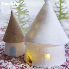 Felt and glue transform plastic containers and corks into a winter wonderland. Set tea lights inside the larger cottage to cast a pretty snowflake shadow on the roof.