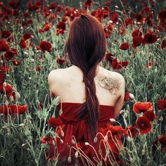 girl in meadow - with red lotus flower tattoo