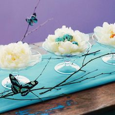 stylish Easter egg bowl table centerpiece flowers branches butterflies