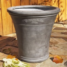 Guy Wolfe planters, I have about eight of these some in this gray and some in a buff terra cotta. Love them.