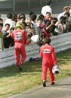 Ayrton Senna of Brazil and Alain Prost of France walk towards their pit 21 October 1990 after they crashed in the first turn right after the start Damon Hill, Alain Prost, Formula 1, Nascar, F1 Crash, Gq, San Marino Grand Prix, Ferrari, Gilles Villeneuve