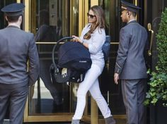kronprinsessa:  New York City, June 2, 2014-Princess Madeleine carrying Princess Leonor as they (including Chris O'Neill) left for Sweden for Leonor's christening on June 8.