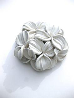 Iris bouquet Wall Sculpture from dillypad.com  #whiteonwhite #iris #artdesign #flowerdecor #gorgeouswalls #sculpture #bohemiandecor #walltile #arttile #claysculpture #polymerclay #whitedecor #whitebedroom