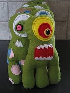 Here is a quick tutorial on how to make these Monster Dolls with a free pattern. I created a batch of these to accompany my boys' birthday party invitations. Each invitee got to keep a silly monster of their very own! A Monster Mash? I began by creating a template {in purple} and cutting monster parts out of felt material. Then I traced the template onto my green flannel and cut out two sides {monster front and back}. I pinned my monster parts onto one of the sides. And began sewing my pa...