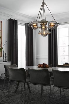 Dining Room Lighting Ideas The Harper Collection Is A Modern Beauty With Light Glowing Through Plated Smoke Glass Globes
