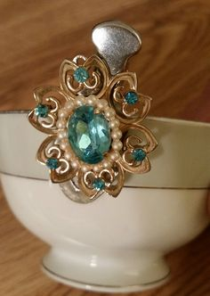 Hair clip/barrette teal rhinestones, gold tone and faux pearl