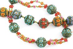 Quick and colourful beaded beads worked over a 12mm base bead.  The pattern is presented over five A4 pages.