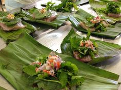 STEAMED BANANA LEAF-WRAPPED FISH WITH SCORCHED COCONUT: This recipe uses the ancient Fijian method of scorching the fresh coconut with a very hot stone before squeezing the coconut milk that gives this dish an unique flavour profile. You could use tinned coconut cream as an alternative. (but obviously would not be the same!). With no oil and steamed, this seafood dish is very healthy and high in essential nutrients.
