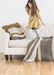 The throw and pillow set with a 3 color stripe pattern is based on a landscape photo we took in Peru. A 1 x 1 rib in double-stranded Bulky makes this a super chunky knit that is soft and dreamy.
